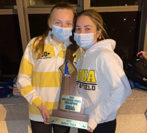 Julia Querey (right) poses with the state title championship trophy.