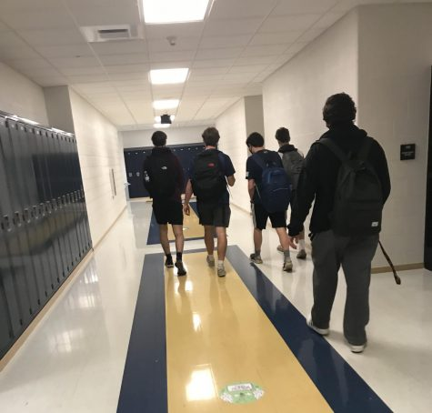 Students walk through Unionville High School as they return to a five-day schedule. Directional hallways are one way the school is reducing the potential of spreading the virus.