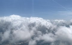 Julianna Bowen flies over the clouds on a recent flight. It was her first plane ride since 2019 due to COVID-19.