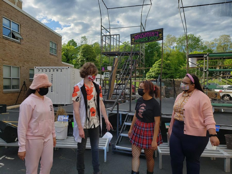 From left, Padua freshman Lauren Perry, Salesianum senior Carmen Rafalli, and Ursuline seniors Amina Hsi and Briarra Barnes rehearse a scene before opening night. They performed outside and masked to follow pandemic restrictions.