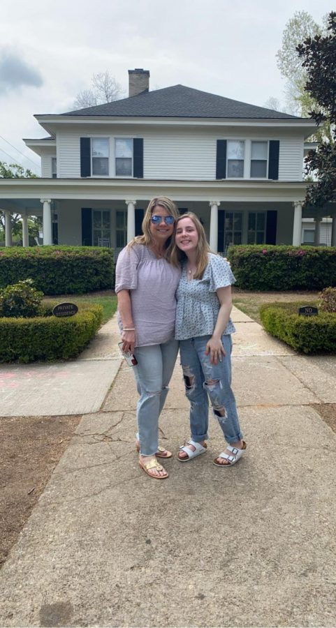 Meri Hilferty poses with her mom. She is the only fraternal triplet out of the three.