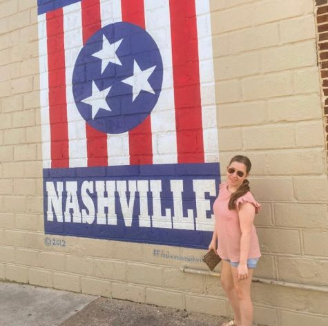 Tory Hilferty poses by mural in Nashville Tennessee. Another fun fact about her is that she loves sushi.