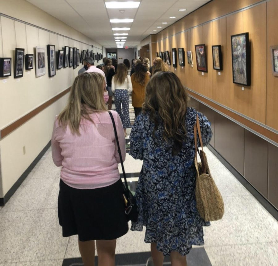 Visitors fill the hallways on their way to the next room. Throughout their tour, they had the chance to look at all the buildings features.